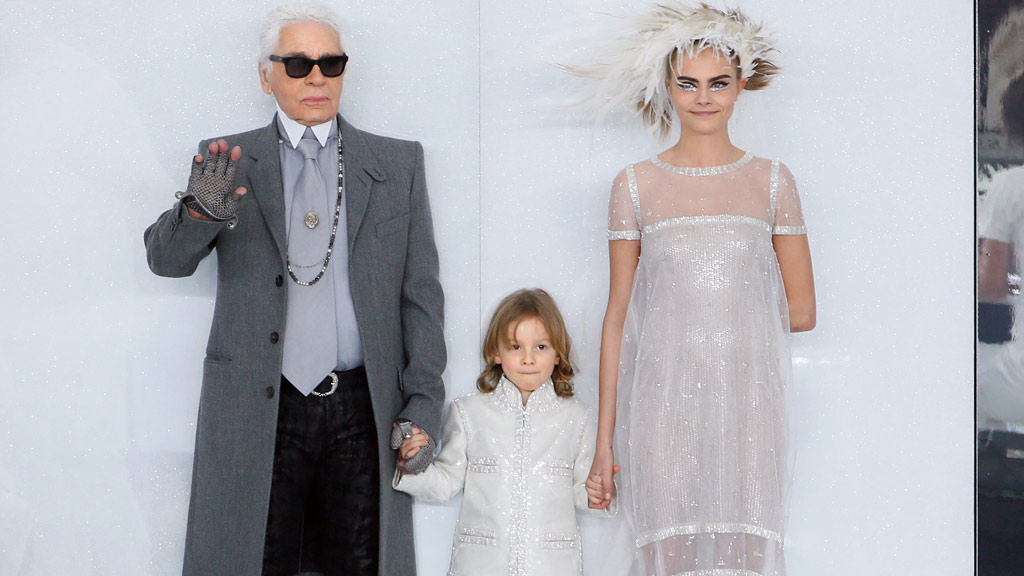 Cara Delevingne with Karl Lagerfeld. (Getty)