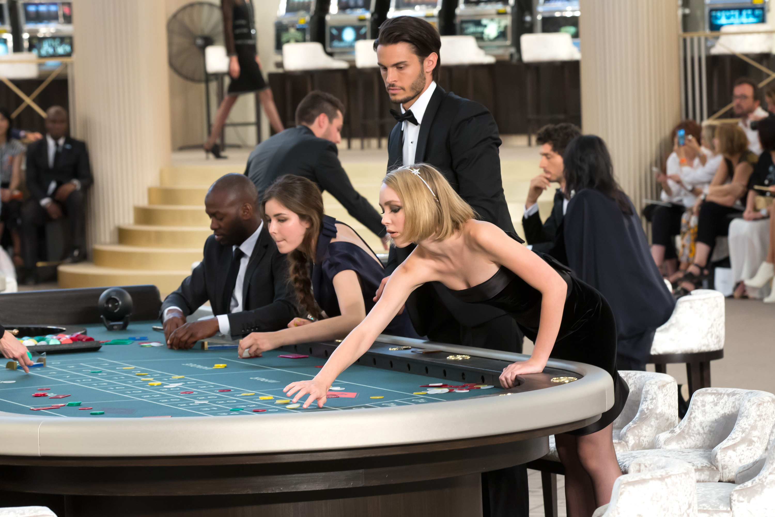 <p>Ever the consummate showman, Karl Lagerfeld created an 80s inspired casino for Chanel's Fall Haute Couture Fall 2015 show. Celebrity guests were seated at tables before models took to the catwalk, blurring the line between runway and front row.<br></p>