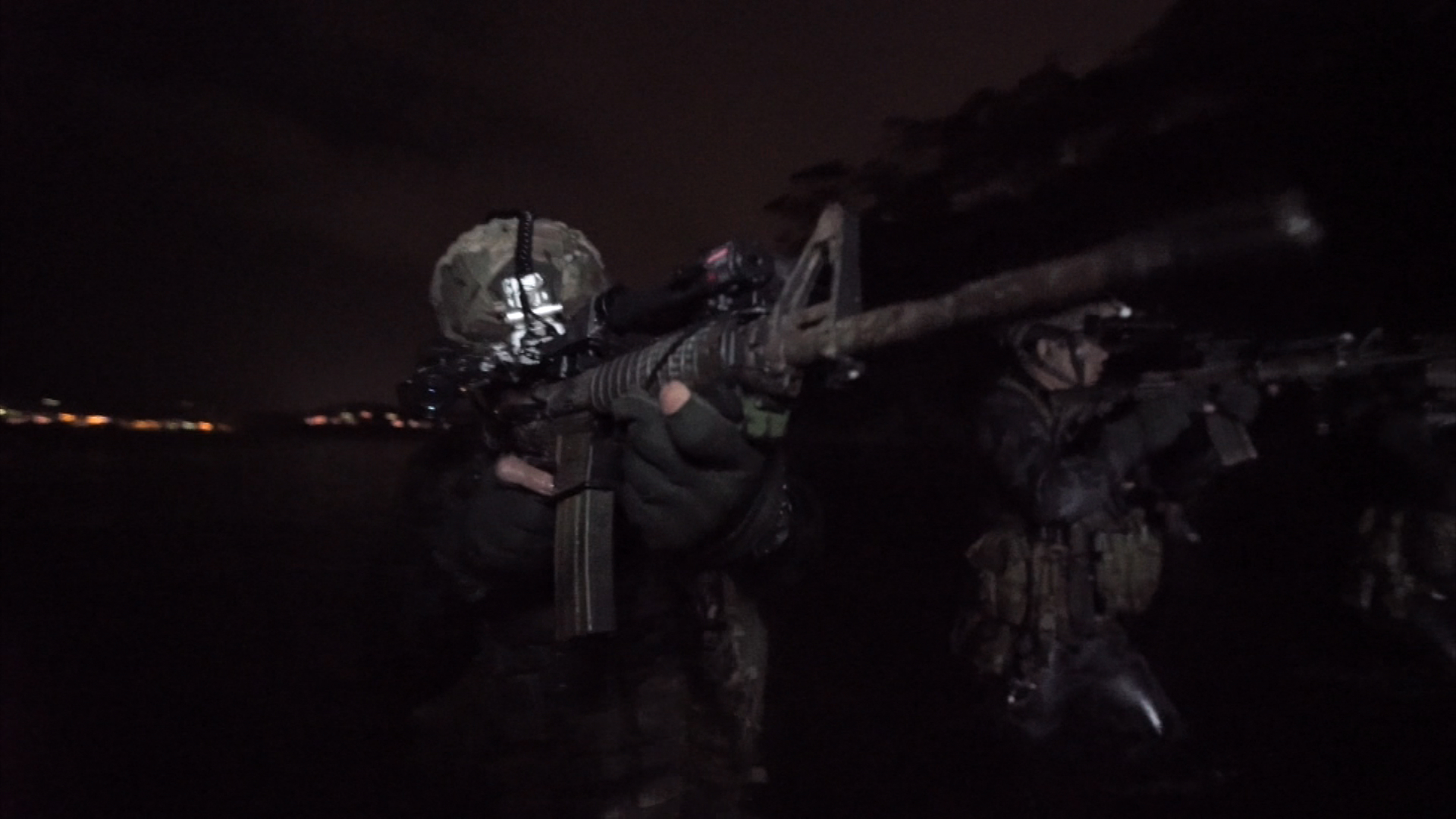 It looks strange to put a gun in water, but these are amphibious Colt M4s. (9NEWS)