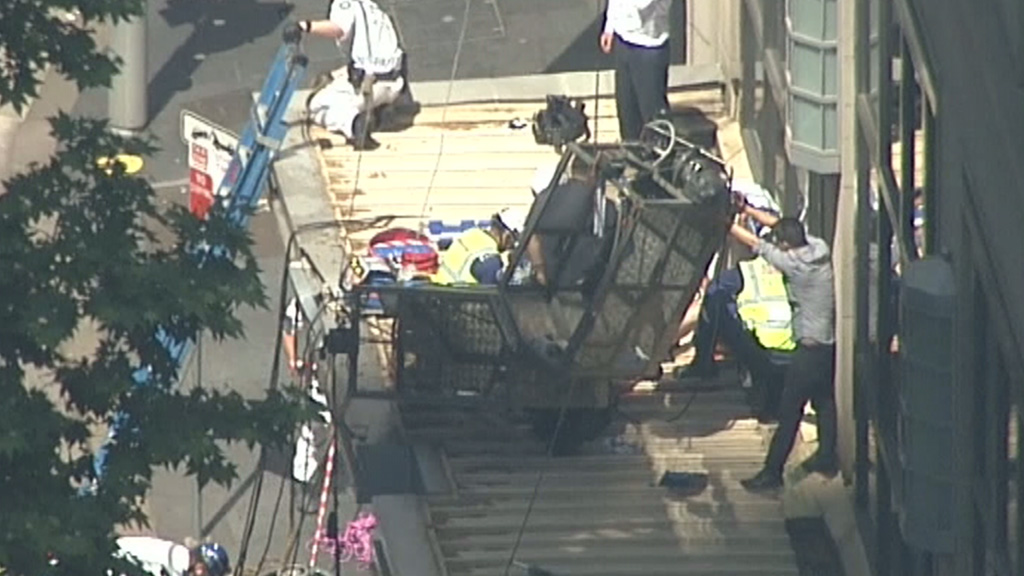 The scaffolding collapsed onto an awning. (9NEWS)