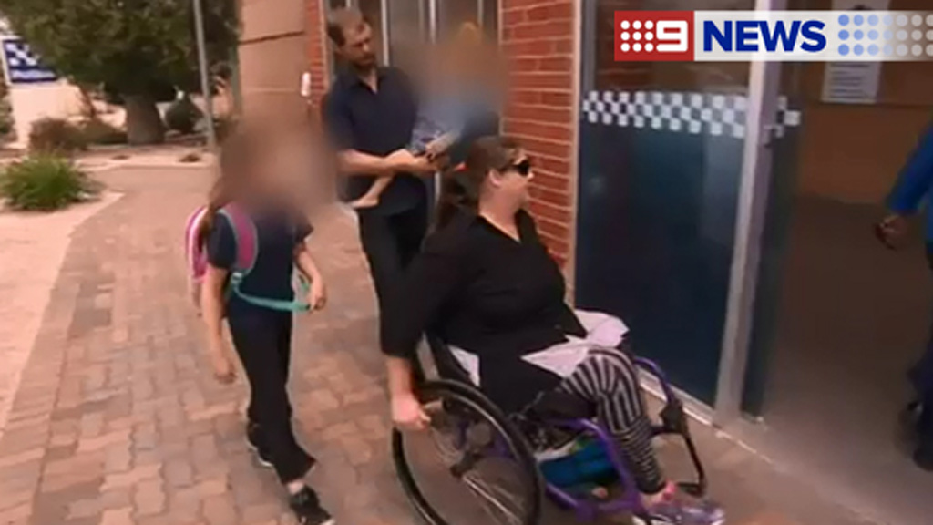 Hazel Passmore arrives at the police station with several children. (9NEWS)