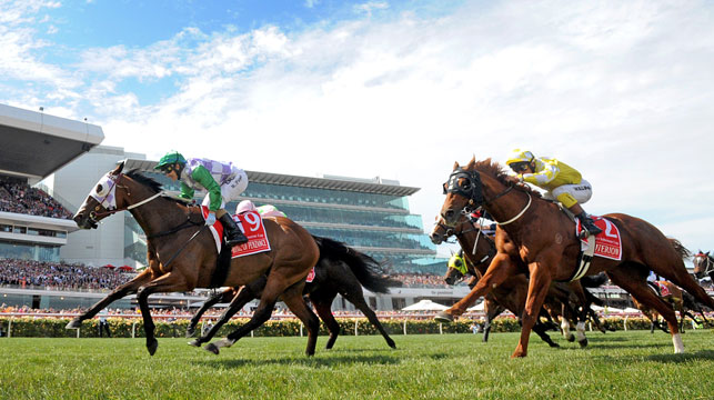 Jockey Michelle Payne, riding Prince Of Penzance, crosses the finish line to win the $6,000,000 Melbourne Cup. (Photo: AAP Image/Joe Castro)