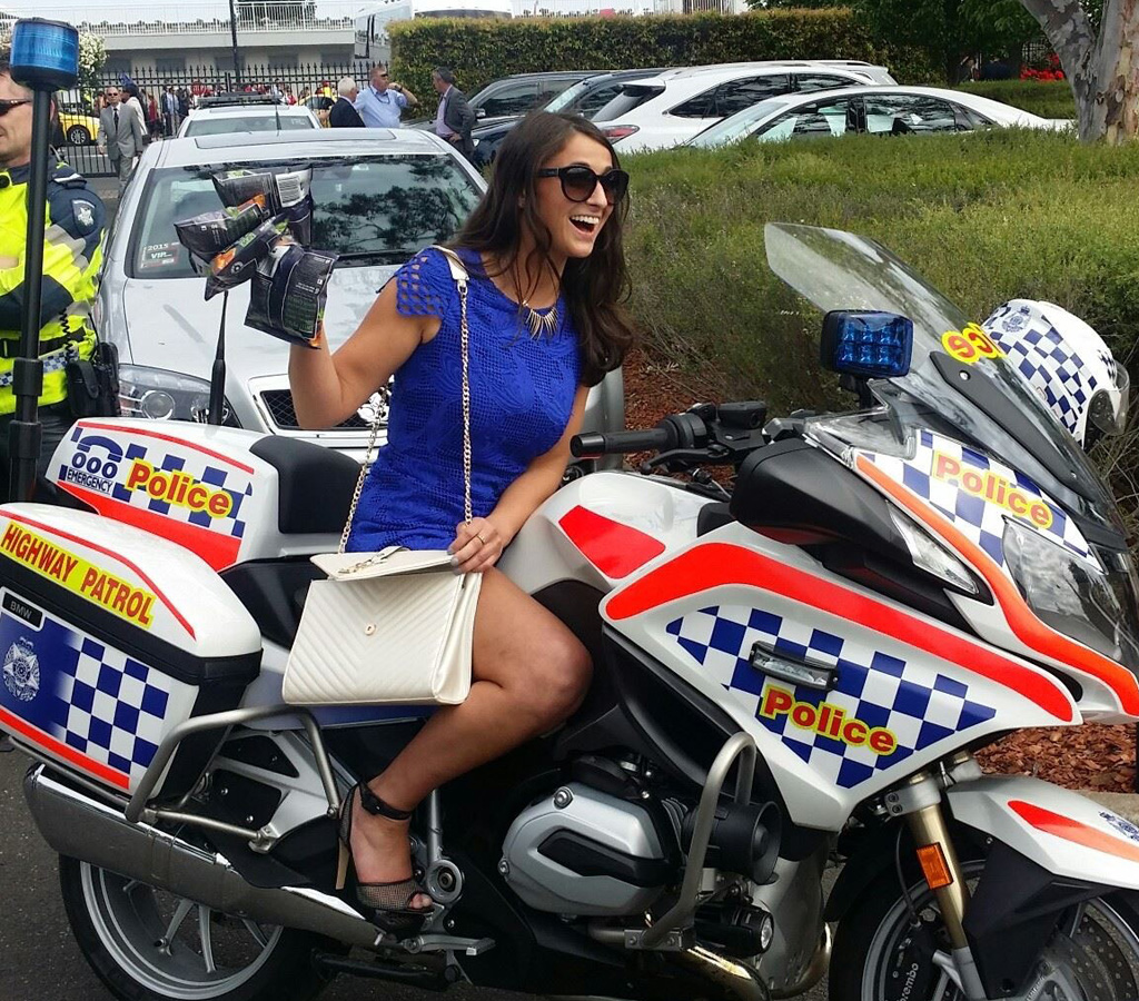 Cup cop pusher earlier posed for happy snap on police bike
