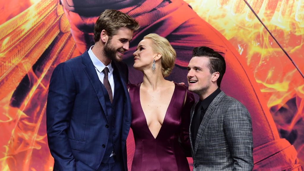 J-Law has wowed at the premiere of her upcoming movie The Hunger Games: Mockingjay - Part 2 in Berlin. Here, Australian actor Liam Hemsworth, US actress Jennifer Lawrence, and US actor Josh Hutcherson pose for photographers. (AFP)