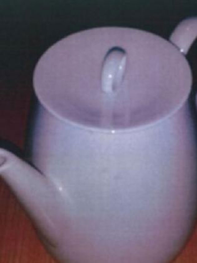 Cash-stuffed teapot left at Victorian charity shop confounds police