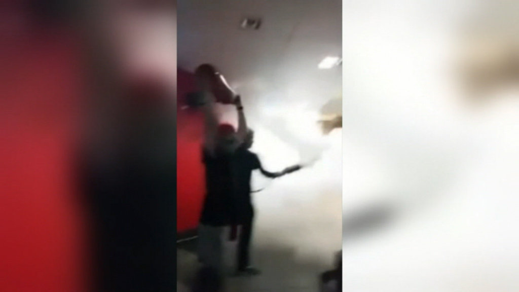 The extinguishers are believed to have been stolen from a store nearby.