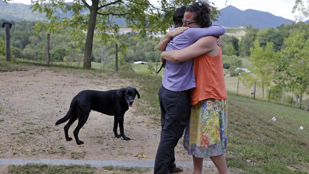Michelle Baker hugging Nicole Shumate who trained Honor. (AAP)