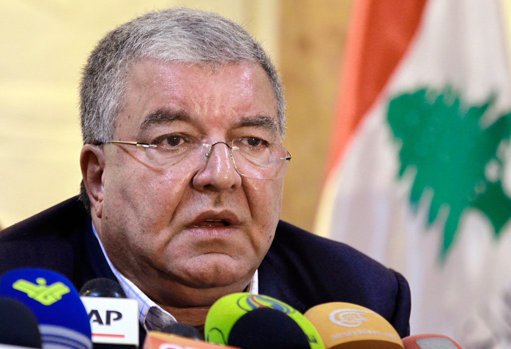 Lebanese Interior Minister Nohad Machnouk told a press conference seven Syrians and two Lebanese were being held over the suicide attacks. (AAP)