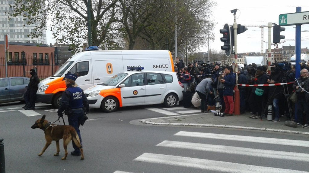 The media gather at Molenbeek. (Twitter/@buddendorf)