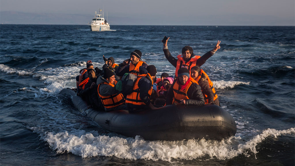 Refugees and migrants arrive safely on a dinghy from the Turkish coast to the northeastern Greek island of Lesbos after a plastic boat overturned near the island of Kos. (AAP)