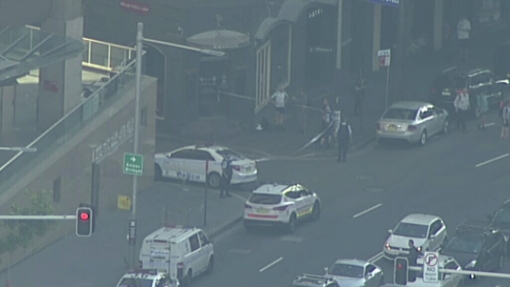 Marked police cars near the building. (9NEWS)