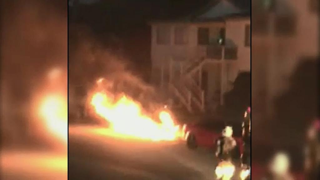 Residents filmed the car fire. (9NEWS)