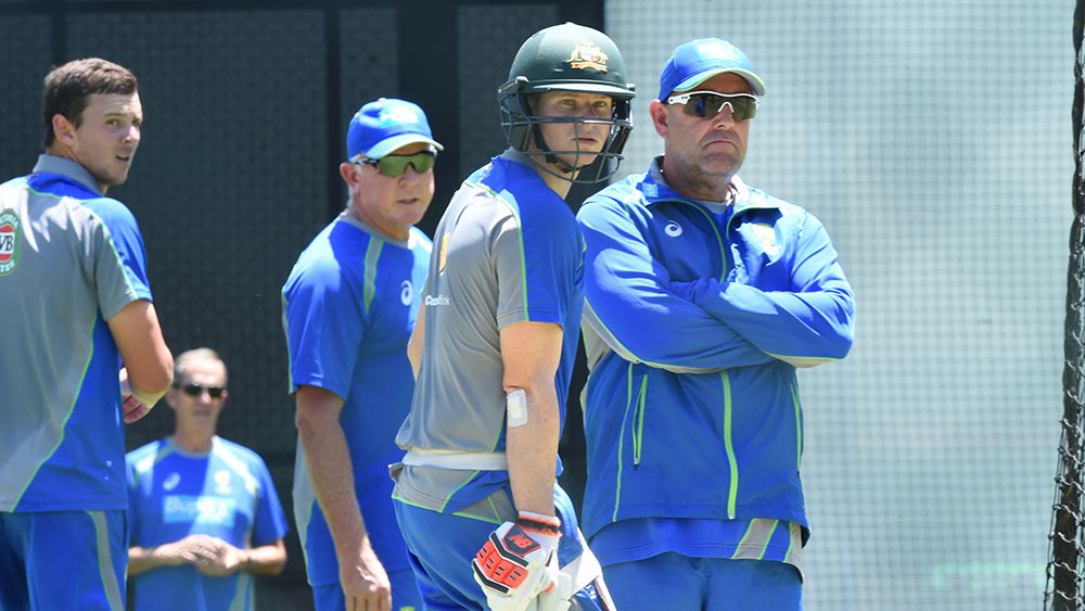 Steve Smith and Darren Lehmann watch on at Australia training. (AAP)