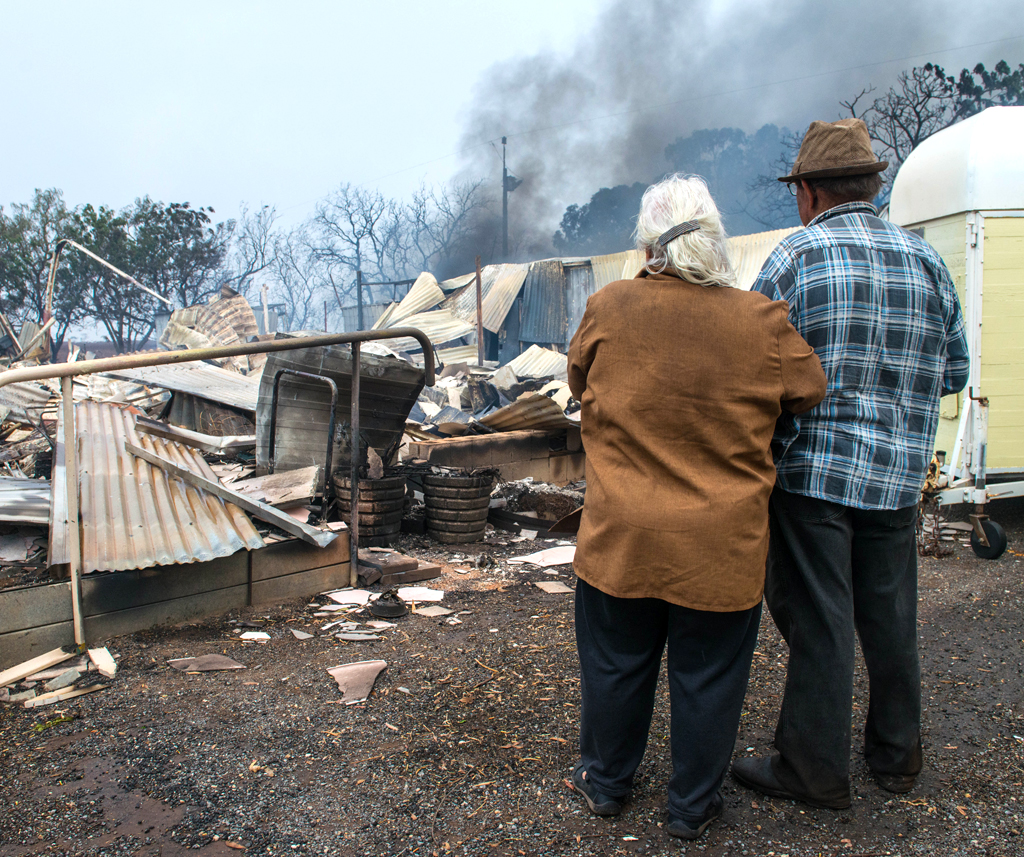 Property owners Jim and Lorraine inspect their destroyed house near Roseworthy in the mid-north of South Australia. (AAP)