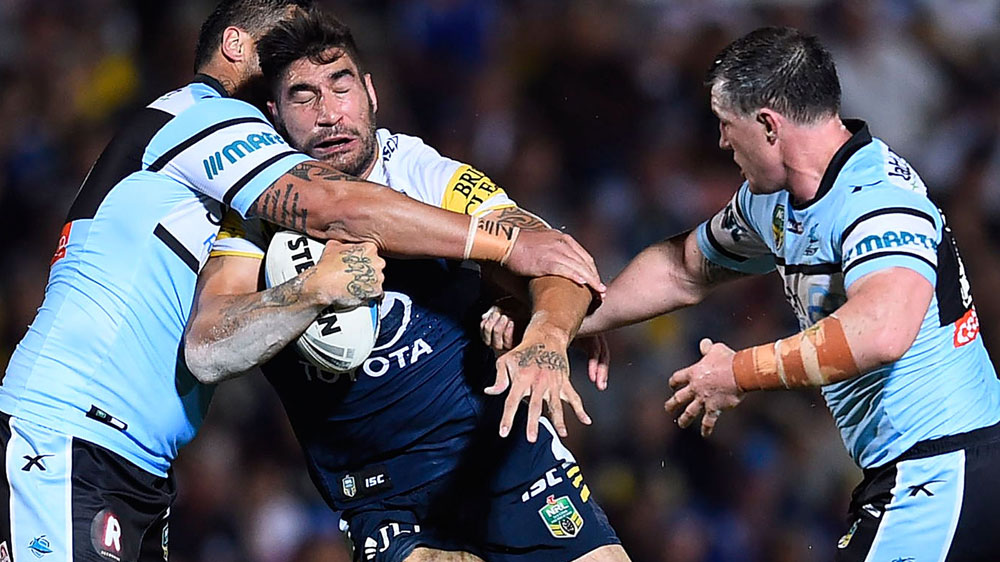James Tamou is tackled during a match against Cronulla in 2015. (AAP)