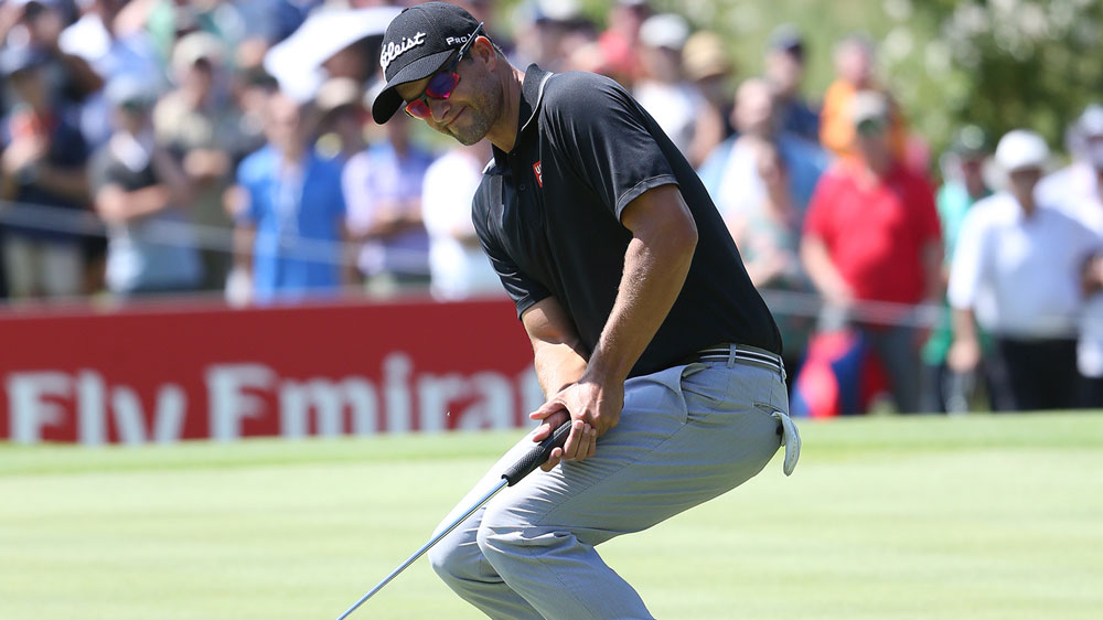 Adam Scott reacts after missing a putt. (AAP)