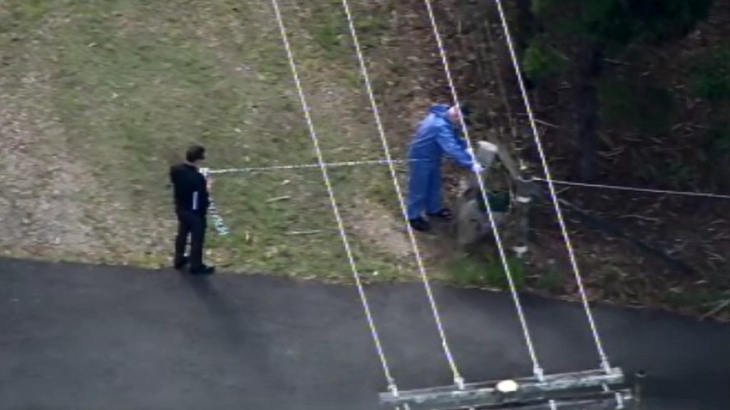Woman charged after man's body found east of Brisbane