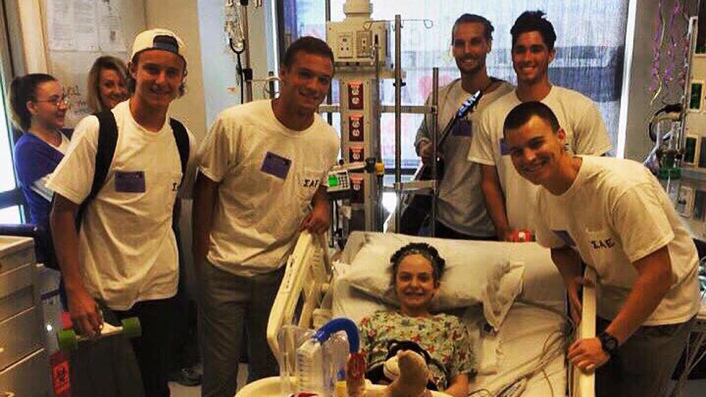 The fraternity brothers have become friends with Lexi Brown who has stayed in the hospital across the road from their house. (Facebook)