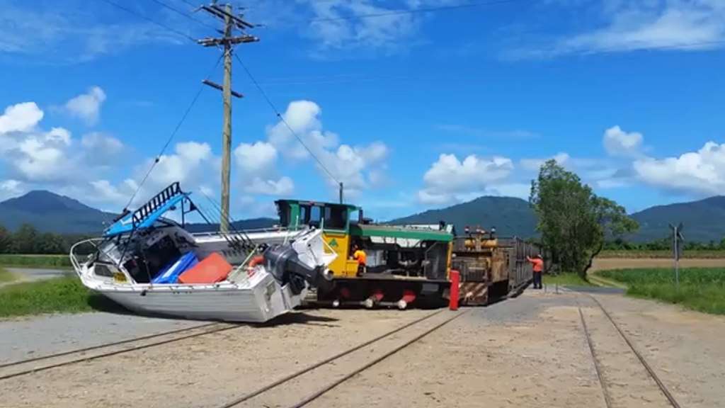 Cane train derails after hitting boat on Cairns tracks