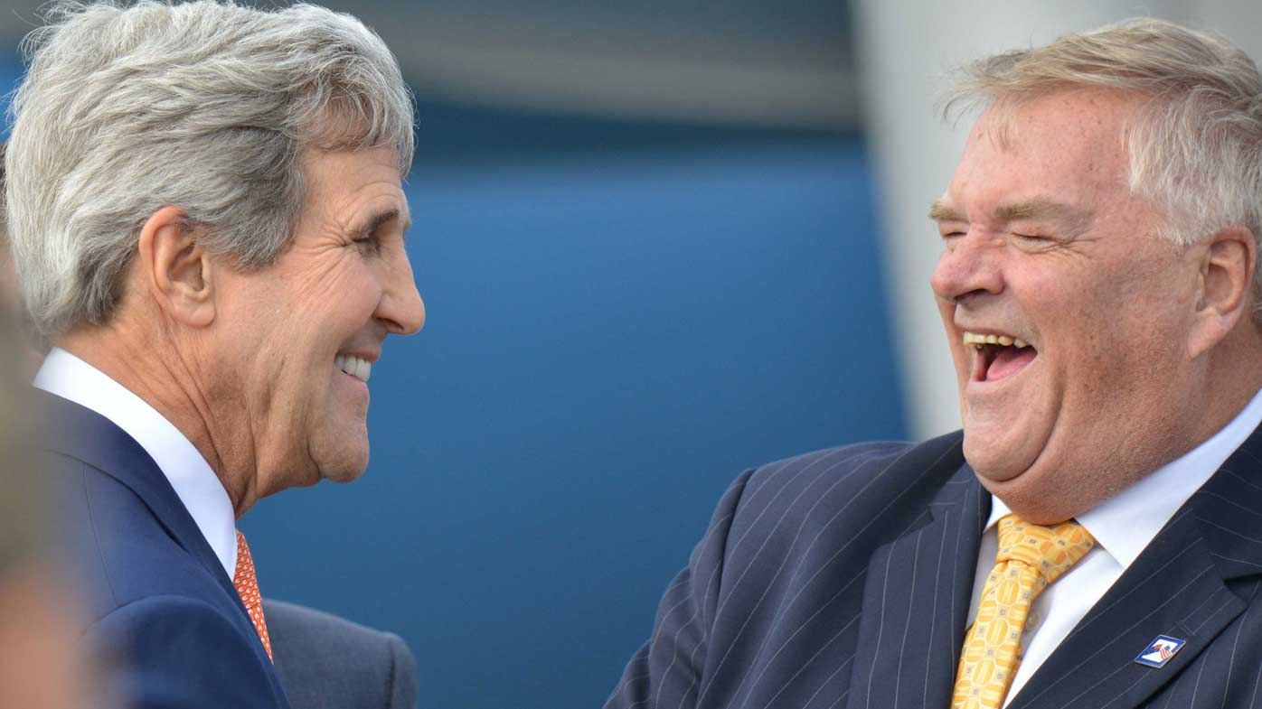 Current US ambassador Kim Beazley (right) with US Secretary of State John Kerry. (AAP)