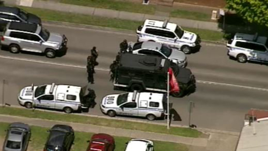 Tactical police with a Bearcat armoured vehicle. (9NEWS)