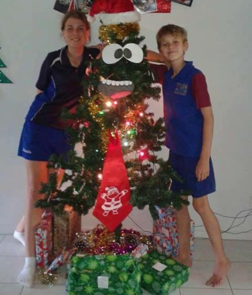 Annabelle and Andrew with a re-erected tree. (Supplied)