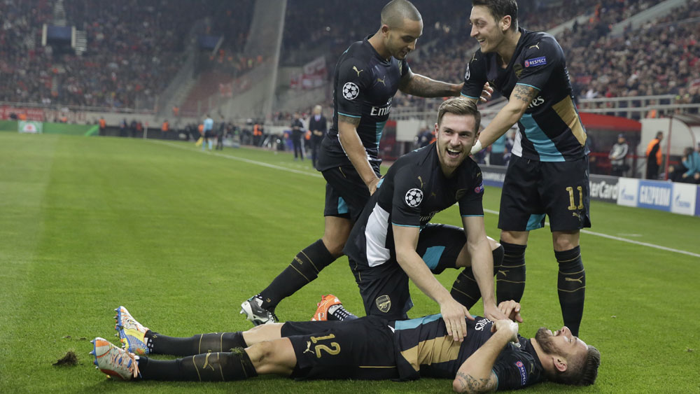 Football: Giroud treble sends Arsenal through to last 16
