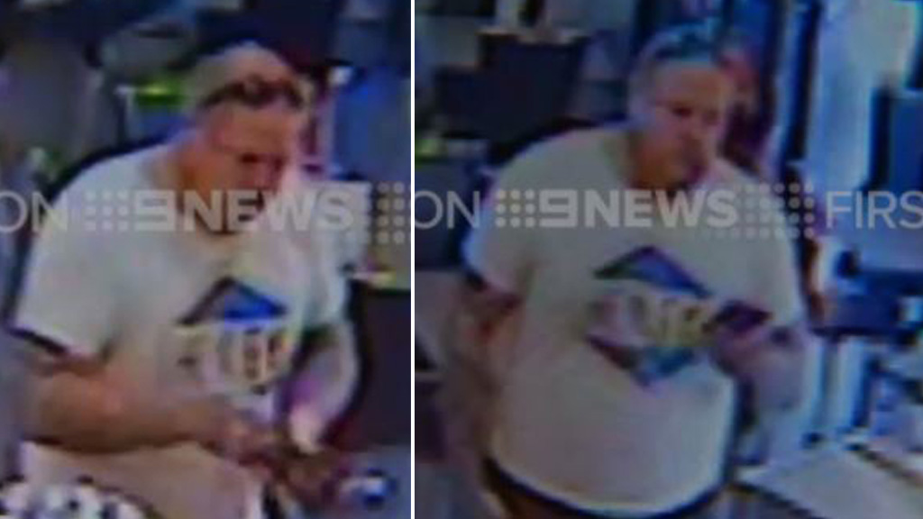 CCTV caught the Rebels bikie paying his bill and checking his phone. (9NEWS)