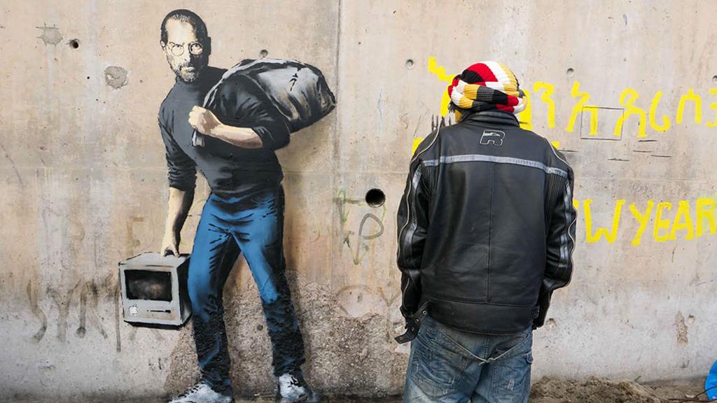 Banksy's artwork of Steve Jobs in Calais 'Jungle' refugee camp highlights benefits of migration