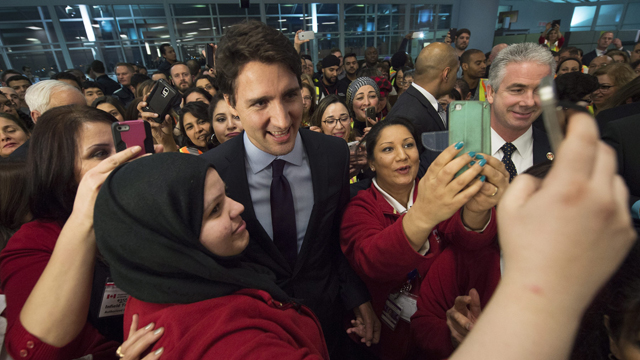 IN PICTURES: Canadian prime minister Justin Trudeau greets Syrian refugees in Toronto (Gallery)
