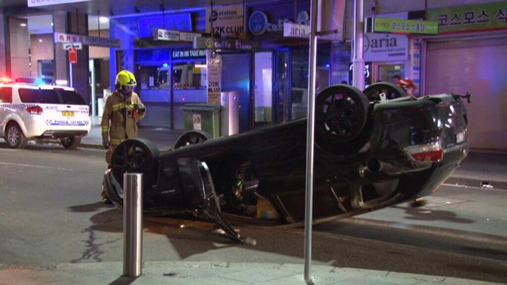 A car rolled over on Pitt Street, Sydney. (9NEWS)