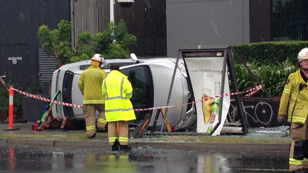 Car rollover closes lanes, downs powerlines on Coronation Drive, Toowong