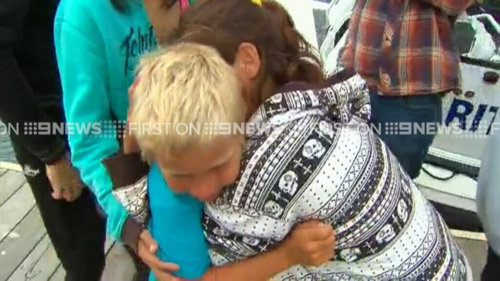Tearful scenes at the dock this afternoon. (9NEWS)