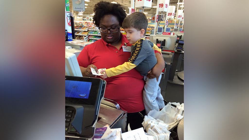 Shop cashier praised by mother for sweet gesture towards her struggling toddler