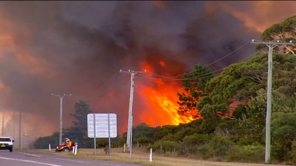 Large bushfire burning at Williamtown, near Newcastle Airport