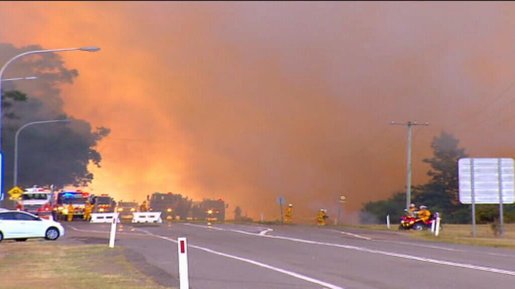 Fire crews battling the blaze. (9NEWS)