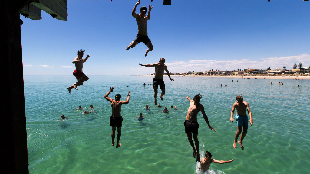 Swimmers cool off at South Australia's Henley Beach. (AAP)
