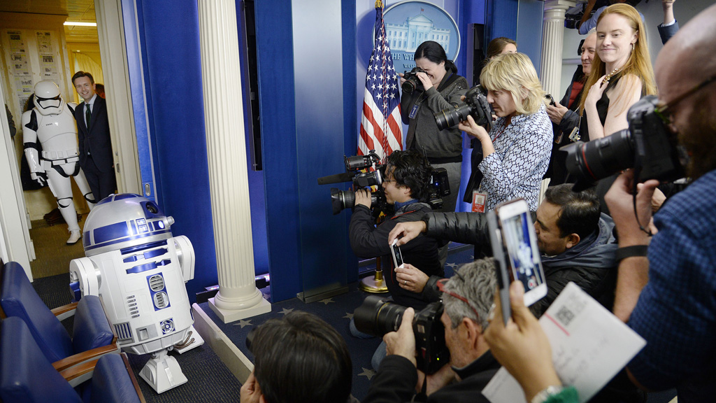 Reporters line-up to take photos of R2D2. (AAP)