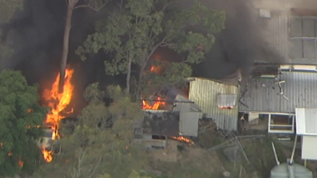 A house and shed fire broke out off Brompton Road, The Gap. (9NEWS)
