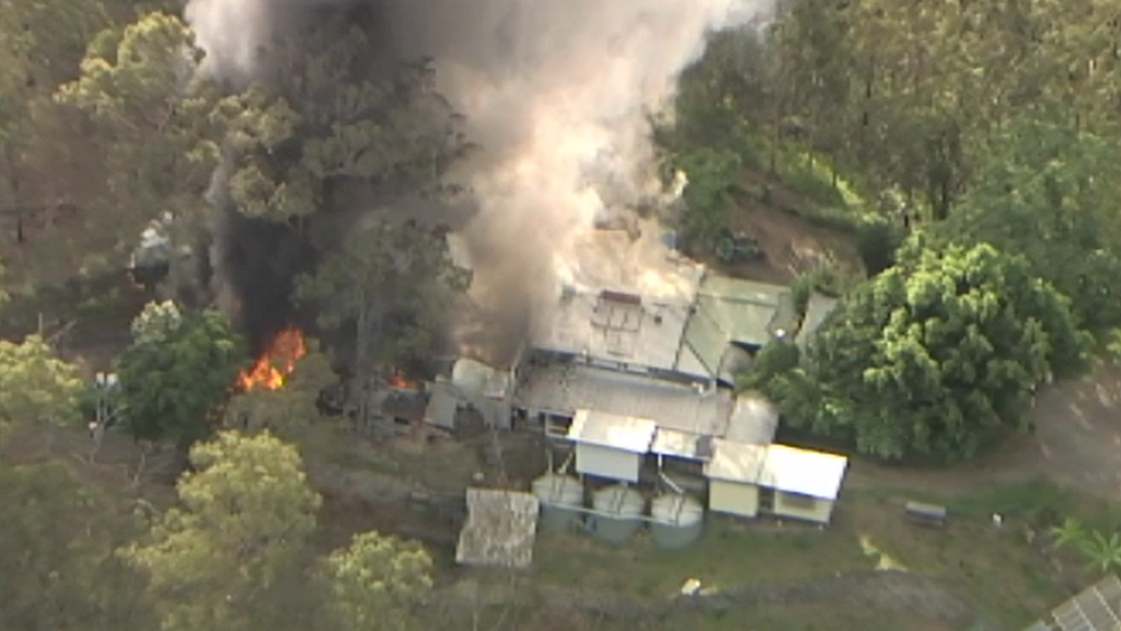 Large fire spread to home after engulfing shed at The Gap, in Brisbane's west