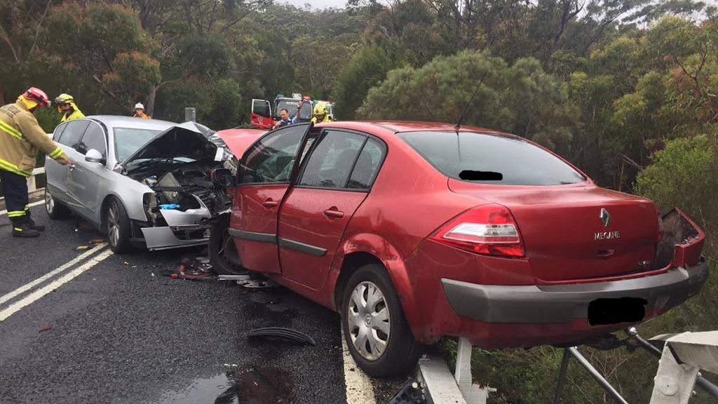 Crash in Sydney's south leaves car hanging over edge of a bridge