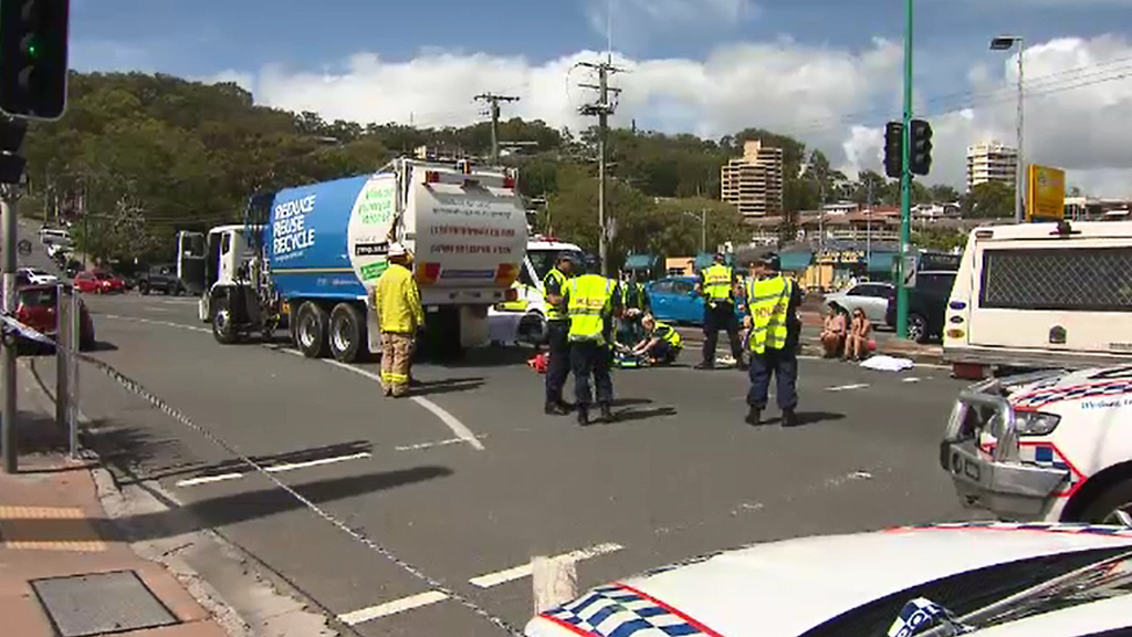 Couple seriously injured after being hit by garbage truck on Gold Coast Highway
