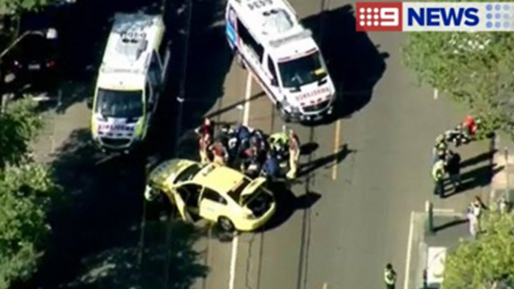 Motorbike rider killed in collision with taxi at Albert Park