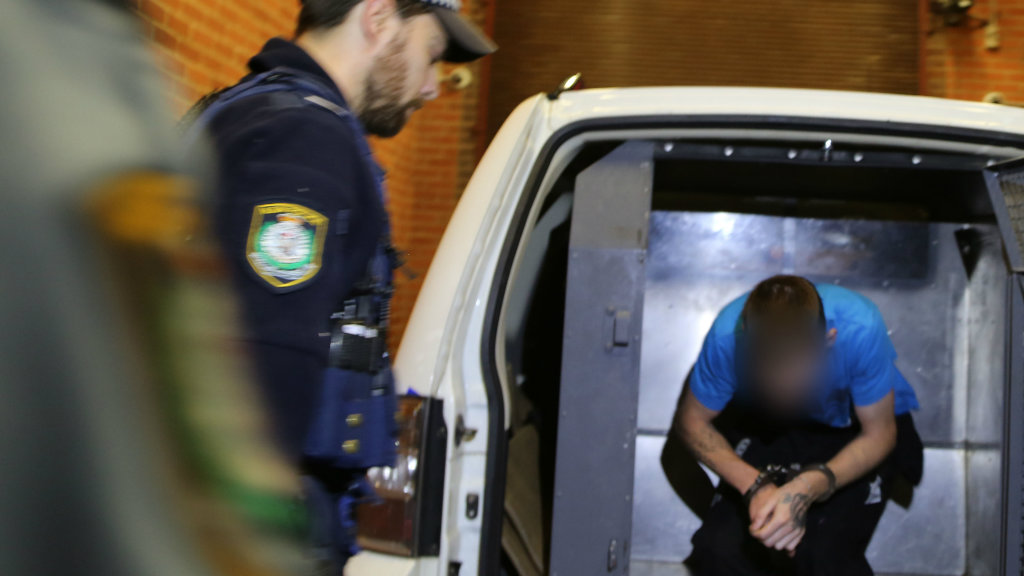 The man arrested in Lawson arrives at Katoomba Police Station. (NSW Police)
