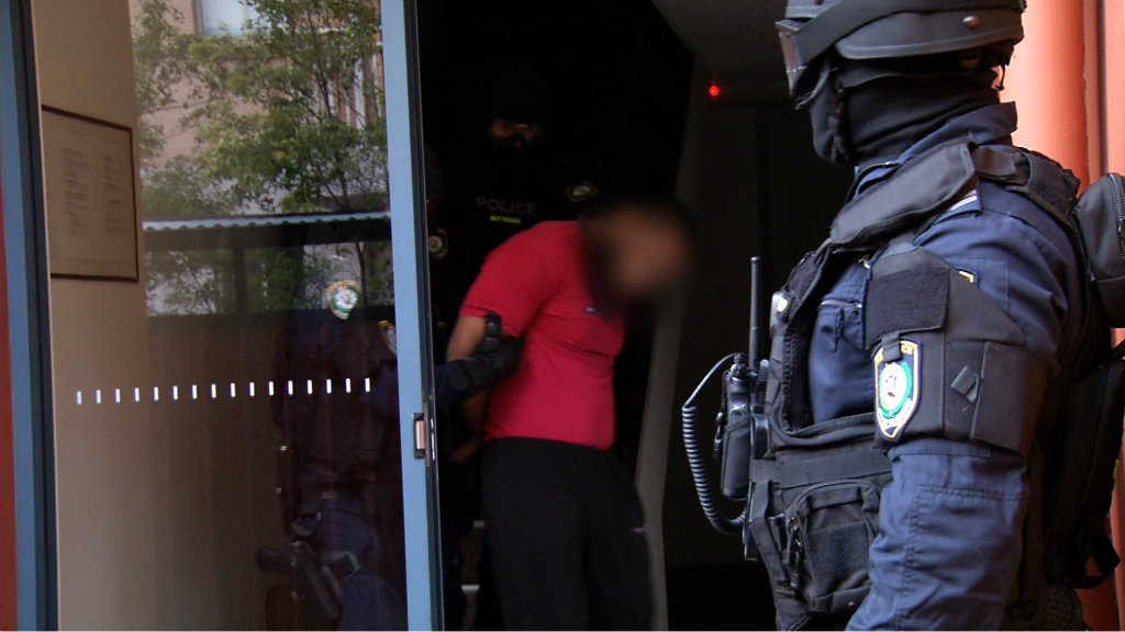 He was one of two arrested in early morning raids today. (9NEWS)