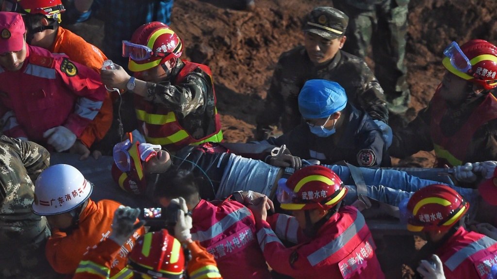 Two survivors found alive in rubble 70 hours after Chinese landslide