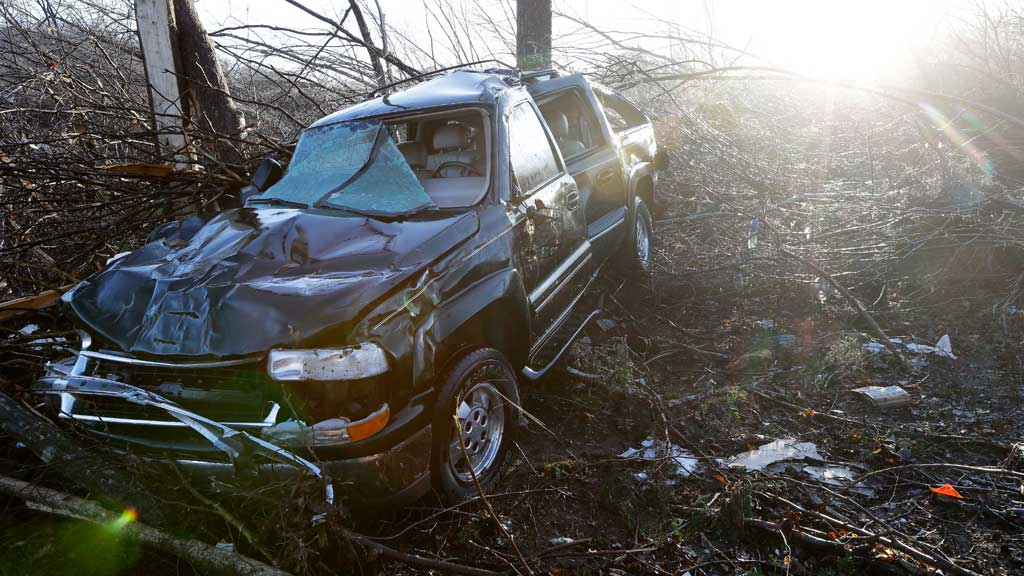 A vehicle sits among debris near the home of Antonio Yzaguirre, 70, and his wife, Ann Yzaguirre, 69, near Linden, Tennessee. (AAP)