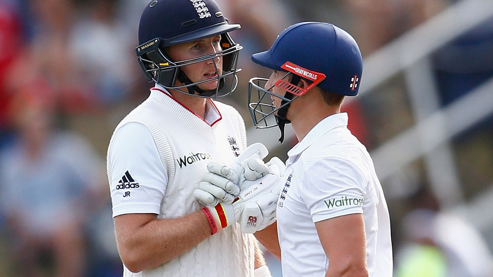 James Taylor (R) congratulated Joe Root during his innings for England. (Getty)
