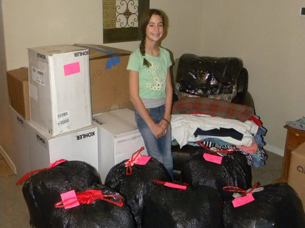 Young girl in the US runs one woman charity collecting clothes for the homeless
