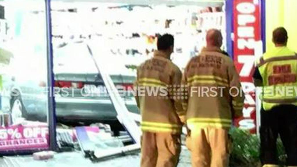 Car plunges through chemist shopfront in Sydney overnight, causing extensive damage